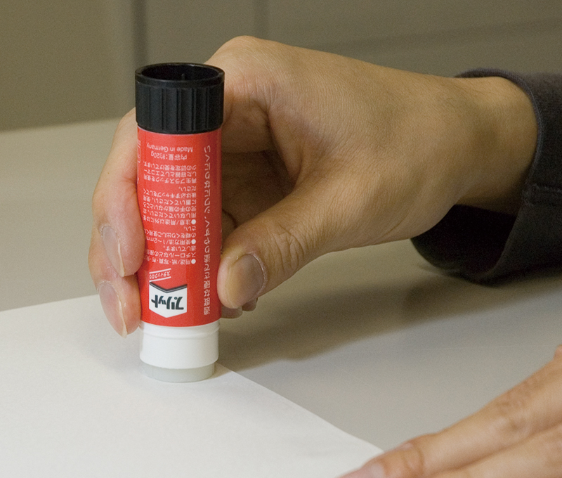 Feed out a few mm of glue and apply, holding the tube perpendicular
