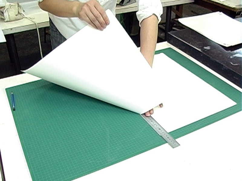 Cutting paper with a ruler