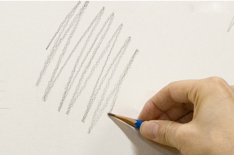 Making lines with the side of the graphite (with the pencil laying against the paper)