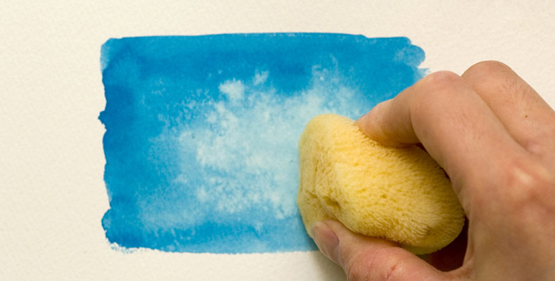 Removing paint with a sponge
