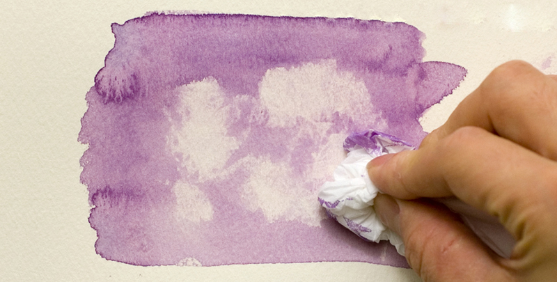 Removing paint with a tissue