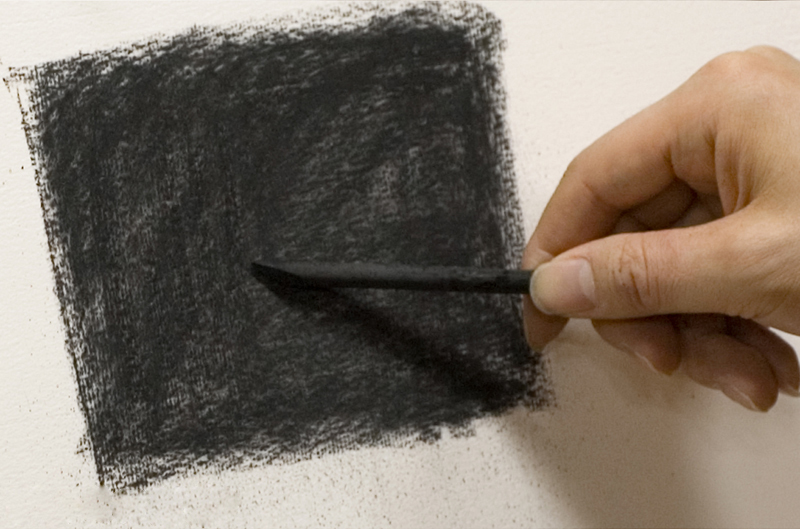 Filling with the charcoal laid against the paper